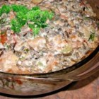 Pork and Wild Rice Casserole - This recipe is a delicious use of wild rice. Just be sure to season your ground pork if you don't buy it preseasoned (usually labeled as pork sausage). Fresh Italian sausage can also be used, just cut open the casing.