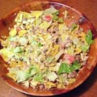 Sue's Taco Salad - This is a great dish for pot-lucks. It's easy, and can be made in advance. Add dressing just before serving.