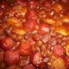 Three Bean Casserole - Sliced hotdogs are baked with chili beans, butter beans, and pork and beans, along with onion, a little brown sugar, oregano, and vinegar in this quick and easy one-pot meal.