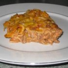 Mrs. Strong's Casserole - Egg noodles are baked with beefy tomato sauce and a creamy mixture of cream cheese and sour cream.