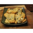 Flaky Crescent Mushroom Turnovers - If you love mushrooms, you'll love this easy hot appetizer. Sauteed mushrooms are baked with cheese inside a flaky crust. Poppy seeds may be used in place of sesame seeds.