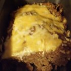 Cheese Stuffed Turkey Meat Loaf - Surprise! A layer of gooey cheddar cheese runs through the middle of this tasty turkey meatloaf.