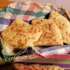 Garlic Cheese Flatbread - Golden brown, chewy and cheesy, this recipe is a hit with Italian dishes.