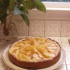 Peach Kuchen - A dense crust of a cake with peach slices arranged on top like spokes. Excellent served with vanilla ice cream.