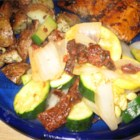 Steamed Squash Medley with Sun-Dried Tomatoes - Zucchini and yellow squash are steamed with sun-dried tomatoes and sweet onions, and tossed with butter.