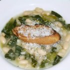 Creamy Italian White Bean Soup - Canned white kidney beans, chicken broth and fresh spinach are used in this flavorful soup.  Serve garnished with shredded Parmesan cheese.