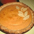 Persimmon Pie - The flavor of this unusual fruit is especially wonderful when baked up with cream, cinnamon, eggs, butter and lemon juice. This luscious filling is poured into an unbaked pie crust and slipped into the oven to let all the flavors mingle until the pie sets. Serve when cool with a scoop of lemon sorbet.