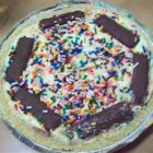Heath Bar Pie - Caramel topping is poured into a 9-inch pie shell and covered with a rich filling made from vanilla pudding, whipped topping, and chopped candy bar pieces. This luscious pie is then frozen and served to raves.