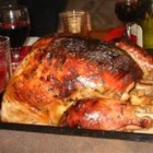 Maple Roast Turkey - A turkey is roasted in a compound butter made with cider, maple syrup, lemon peel and fresh herbs. This recipe includes instructions for making a gravy using vegetables that have been roasted with the turkey.