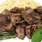 Summer Lamb Kabobs - Lamb and garlic go so well together. In this recipe, the combination of herbs and spices complement the meat and make an awesome treat for friends and family.