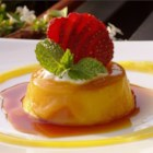 Flan III - Creme caramel made with cream and flavored with orange liqueur, baked in individual ramekins.