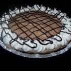 German Sweet Chocolate Pie - An easy frozen German chocolate mousse that is whipped up with cream cheese and frozen whipped topping.