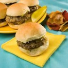 Favorite Hamburger Bites - In this crowd pleasing recipe, seasoned ground beef is browned and mixed with mayonnaise and shredded cheese. The mixture is spooned onto dinner rolls and garnished with a pickle.