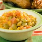 Succotash - Lima beans and tomatoes are stewed with butter, then simmered with corn.  This is fabulous with fresh summer veggies, but frozen or canned can be used.