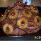 Sangria Ham - Allow half a day to roast this bone-in ham studded with whole cloves and basted in a red wine and pineapple juice punch.