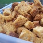 Croutons - Stale bread that is buttered, seasoned, and baked till crispy make these inexpensive croutons that everyone will surely enjoy.