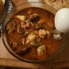 Southern California Cioppino - This popular dish originated around Monterey Bay, California.  This version, created in San Diego, has a southwest flavor. Serve with large bibs, crab shell crackers, extra bowls for the shells, and finger bowls if you wish.  Nice served in large, shallow bowls alongside crusty sourdough bread, a green salad, and chilled white wine.  You can vary the seafood according to the catch of the day, yours or your market's.