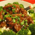 Szechuan Beef - Sliced sirloin is marinated in soy sauce spiced with red pepper and garlic, then stir-fried with broccoli, onion, water chestnuts and peanuts.