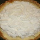 Sour Cream Lemon Pie - First you make a very creamy and rich egg custard. Then you stir in butter, fresh lemon juice, bits of lemon rind and sour cream. Pour this refreshing filling into a baked pie shell, chill the pie, and garnish it with sprigs of mint and thin slices of lemons.