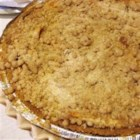 Warm Apple Buttermilk Custard Pie - Warm apple slices are sugared and coated with cinnamon, and arranged in the bottom of a pastry crust. A thick buttermilk custard is poured on top, and then the pie is baked for 30 minutes. Then a buttery, sweet streusel topping is added, and the pie is slipped into the oven to finish baking.