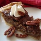 Pecan Pie V - A pecan pie without the corn syrup. Pecans, white sugar, and brown sugar are combined to create a satisfying dessert.