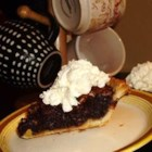Chocolate Pecan Pie I - This is made just like a traditional pecan pie, with the addition of chocolate chips. It is very fudgy. It is always the first dessert to go at our family's Thanksgiving!