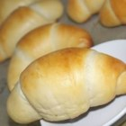 Butter Crescents - Milk, butter, and eggs yield a soft and delicate yeast roll. The attractive crescent shape makes them look as special as they taste.