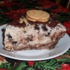 Southern Comfort Ice Cream Pie - Ice cream, hot fudge and nuts are layered in a graham cracker crust.