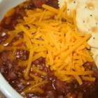 Jim Kaczmarek's Chili - Enough chili for a big party!  The secret ingredient for this recipe is a 12 oz. bottle of beer.  Serve with grated cheddar or jalapeno jack, sour cream, salsa, and chopped onion.