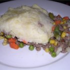 Ground Beef Shepherd's Pie - Freshly cooked vegetables add lots of savor and nutritional value to this baked casserole. It is topped with mashed potatoes and optional cheese.