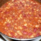 Calico Beans - Pork and beans, kidney beans, butter beans, and lima beans mix it up with browned ground beef and bacon in a sweet and tangy sauce for a crowd-pleasing one-dish meal.