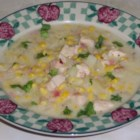 Corn and Chicken Chowder - Diced ham and onion add flavor to this corn, potato and chicken stew in a skim milk and chicken broth soup base seasoned with thyme.
