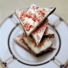 Layered Peppermint Bark - I never liked peppermint bark until I tried this recipe. The soft ganache center contrasts perfectly with the crunchy peppermints.