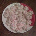 Meringue Kisses II - Decorate with finely crushed nut brittle or other crushed candy.  I have used crushed mints with success.  You can use whatever flavoring extract you choose: almond, vanilla, lemon, etc.