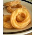 French Crullers - Fried doughnuts glazed with a confectioners' sugar frosting.