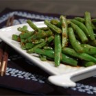 Oriental Green Bean Salad - Spicy and tasty come to mind. Ginger, garlic and crushed red chilies are cooked in a bit of oil and then green beans are tossed in. That cooks for a few minutes and then soy and oyster sauce are added. When the sauce thickens, it 's time to serve.