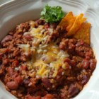 Sharon's Awesome Chicago Chili - Every time I make this chili, people beg for the recipe. My husband wants this made at least once a month. It is delicious topped with shredded Cheddar cheese and sour cream.