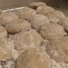Cream Cheese Snowball Cookies - Plump, tender little cream cheese cookies, rolled in confectioners' sugar and optional walnuts, look like little snowballs. They have a hint of almond flavor.