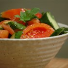 Tomato Cucumber Salad with Mint - A refreshing and simple summer salad that's perfect for picnics or barbeques. Cucumbers are marinated in red wine vinegar, sugar, salt, chopped tomatoes, red onions, mint, and olive oil; great with a spicy flank steak and potatoes.