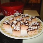 Peppermint Bars - Christmas bar cookie.  Dough is similar to sugar cookie with peppermint added.  Topped with melted chocolate and crushed candy canes.