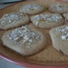 Glazed Orange Spice Cookies - These sweet almond cookies are spiced with nutmeg, cinnamon, and cloves and topped with a sweet orange glaze.