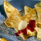 Easy Swedish Pancakes - This recipe is so delicious and easy to make.  I come from a really Swedish town - Rockford, Illinois - where Swedish pancakes are a favorite for Sunday morning breakfast.  My Dad used to make these for us at home for a special treat. Serve with butter and maple syrup, or lingonberries if you've got them.
