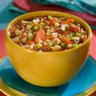 Manhattan Style Clam Chowder - This generous recipe makes enough for twelve!  It is full of vegetables - tomatoes (of course), carrots, celery, potatoes, red and green peppers - and is seasoned with basil, oregano, Worcestershire, and hot pepper sauce.