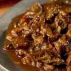 North Carolina-Style Pulled Pork - Pork butt receives a vigorous, spicy rubdown, then is slowly smoked until tender. The meat is then pulled and simmered in a piquant vinegar sauce.