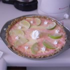 Margarita Party Pie - The crust is made with buttery and sugared crushed pretzels. And the festive filling is a delicious concoction of Triple Sec, tequila, condensed milk and fresh lime juice. Half the filling is poured into the crust, and the other half is folded into sliced strawberries and a colorful whipped cream.