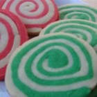 Christmas Pinwheel Cookies - Sheets of red and green butter cookie dough are rolled around each other to make a log of spiraling colors. Sliced into colorful pinwheels, these heirloom cookies are the perfect holiday treat. They can also be made in a chocolate-vanilla pinwheel variation.