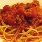 Spaghetti With Red Clam Sauce - Add canned clams to a snappy simmer of tomatoes, capers, garlic, sugar, parsley, oregano, basil and crushed red pepper to make a flavorful sauce for hot spaghetti.
