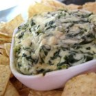 Artichoke & Spinach Dip Restaurant Style - Alfredo sauce brings a rich, creamy twist to an old favorite. Serve this hot dip with bread sticks, chips or crackers.