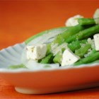 Green Bean and Feta Salad - Sweet onion, fresh green beans, feta cheese, garlic and several vinegars mingle in this piquant salad.