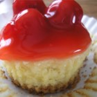 Mini Cheesecakes III - This recipe makes 6 miniature cheesecakes in muffin cups. Excellent topped with fresh fruit or jelly.